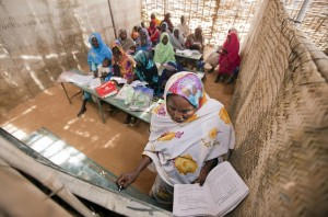 A view inside Abu Shouk Internally Displaced Persons (IDP) Camp's Women Center, in North Darfur, Sudan, where classes are offered in Arabic, the Koran and Mathematics. Approximately 80 women attend the classes, usually taking their children along with them. UN Photo/Albert Gonzalez Farran.