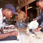 Developing Capabilities - Three South African men in a carpentry workshop