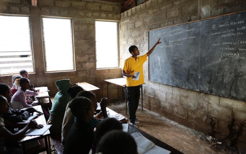 Young teacher at a blackboard