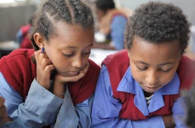 A girl and her classmate read. Hidassie School, Addis Ababa, Ethiopia, November 2013. Picture: GPE/Midastouch.
