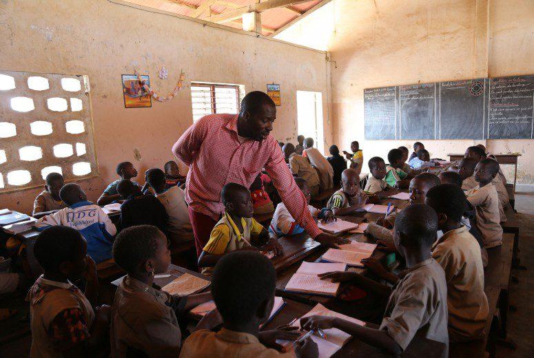 Male teacher in african classroom