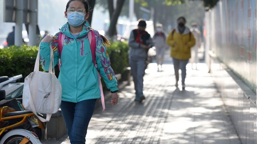 People walking in the street with facemasks