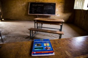 Ethiopian school empty classroom and desk with textbook