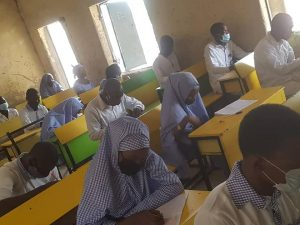 Class in Nigeria with students wearing masks