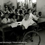classroom scene with child in wheelchair