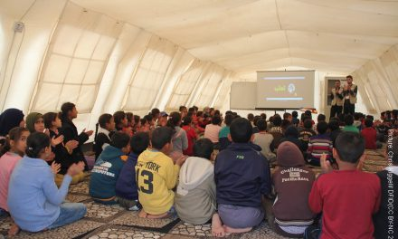 Chiildren in temporary classroom in a refugee camp