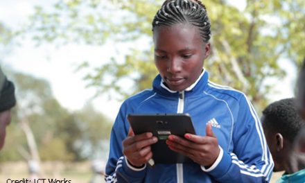 Student holding a mobile device
