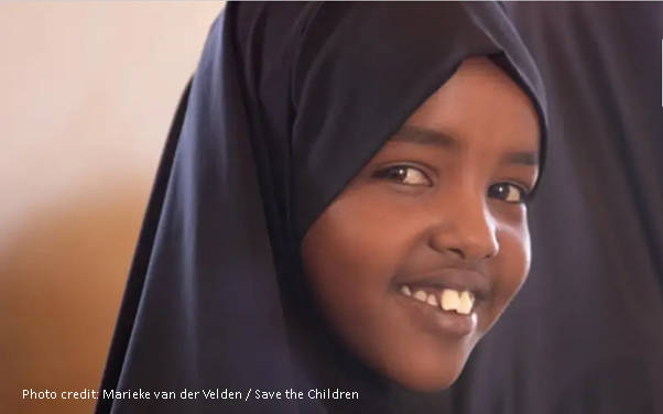 smiling girl wearing a headscarf