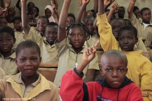 African Children with hands up in class