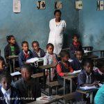 Primary school teacher in her class