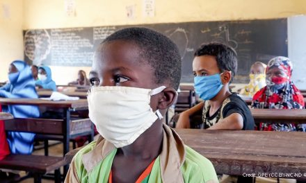 Primary age children in classroom in Niger, wearing masks
