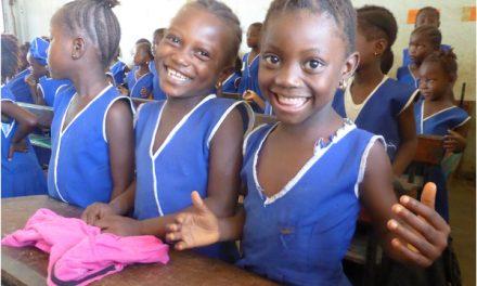 smiling girls in a classroom in Sierra Leone