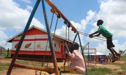 children play in the playground of their pre-school, Uganda.