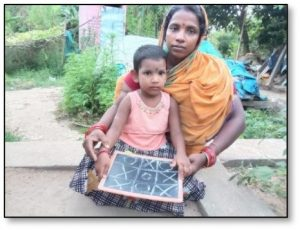 Mother with sitting with child on her knee with a small blackboard
