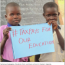 Ugandan boys holding up a sign saying #TAX PAYS FOR OUR EDUCATION