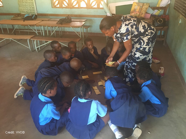 A teacher engages students through play in the classroom in Zambia