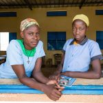 Two teenage girls at their classroom window, Niger.