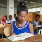 Girl reads in the library at a special needs school, Oromia, Ethiopia