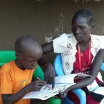 South Sudanese volunteers assess a child's reading